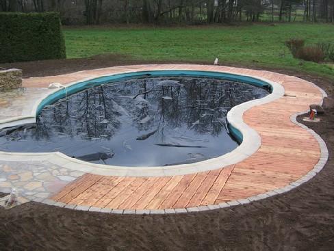 evasion jardin paysagiste r f rences les abords d 39 une piscine. Black Bedroom Furniture Sets. Home Design Ideas