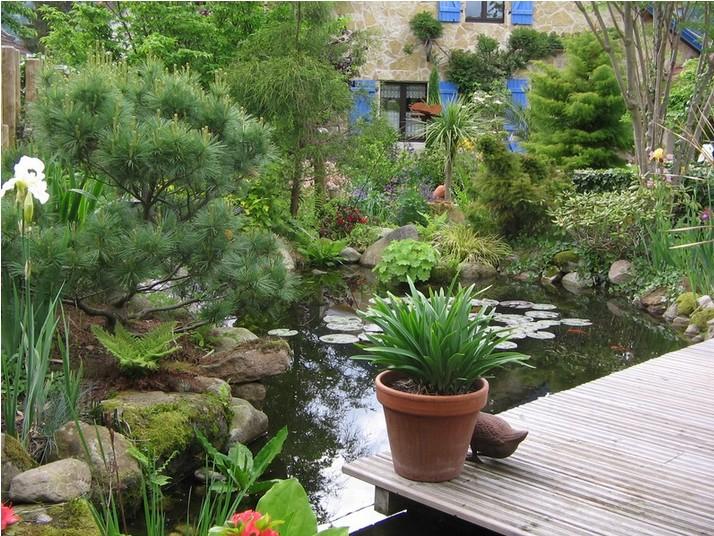 Evasion jardin paysagiste r f rences un style proven al for Bassin sur terrasse